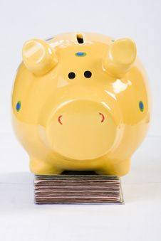 Free Piggy Bank Standing On Money Royalty Free Stock Images - 4561119