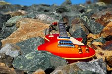 Free Guitar On The Rocks Stock Photography - 4561412