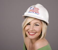 Blonde In Hard Hat Smiling Royalty Free Stock Photo