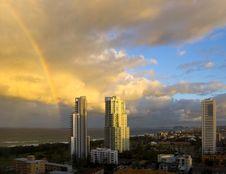 Rainbow Over City On Beach Royalty Free Stock Photo