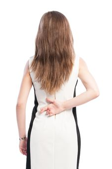 Free Woman Holding Fingers Crossed Behind Her Back Stock Photography - 45687642