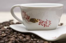 Cup And Coffee Grains Over Sackcloth