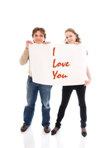 The Happy Couple With A Poster Isolated On A White Stock Photography