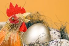Free Cock And Eggs In A Nest Stock Photography - 4577532