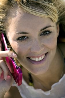 Free Smiling Woman Holding A Mobile Phone Stock Image - 4578211