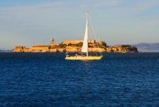 Sail Boat Next To Alcatraz Island Royalty Free Stock Photos