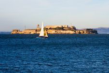 Sail Boat Next To Alcatraz Island Stock Images