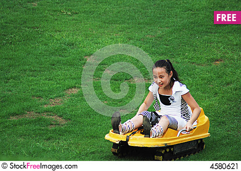 Free An Girl Doing Slippery Grass Movement Stock Image - 4580621