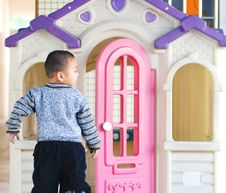 A Chinese Boy And Doll House Royalty Free Stock Photos