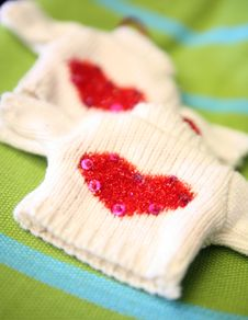 Free Tiny Knitted Sweater With Hearts And Sequins Royalty Free Stock Photo - 4584075