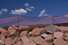 Free Orange Fence And Large Rocks Royalty Free Stock Photo - 4586315