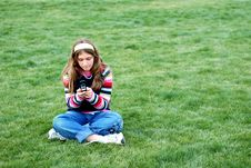 Free Young Girl And Cellphone Stock Image - 4587881
