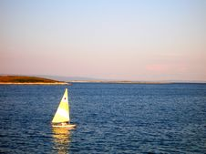 Rowing Yellow Sailing Boat Stock Images