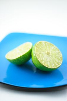 Free Limes On Blue Plate Macro Royalty Free Stock Photos - 4593358
