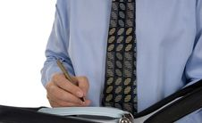 Business Man Writing In Leather Organizer Royalty Free Stock Photography