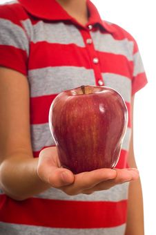 Child Offering Red Apple Stock Photos