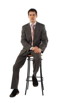 Free Young Businessman Sits On Stool Stock Image - 4594341