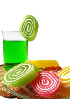 Multi-coloured  Fruit Candy And Cold Green Drink Royalty Free Stock Image