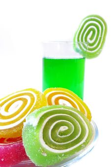 Multi-coloured Fruit Candy  And Cold Green Drink Stock Photography