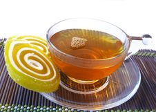 Free Multi-coloured Fruit Candy And Cup Of Hot Tea Stock Photo - 4598580