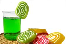 Multi-coloured Fruit Candy And Cold Green Drink Royalty Free Stock Images
