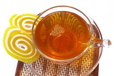 Multi-coloured Fruit Candy And Cup  Of Tea Stock Photos