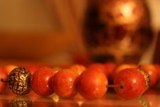 Coral And Golden Marbles Stock Photography