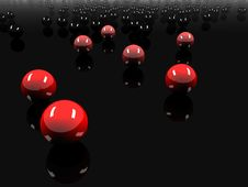 3D Colored Balls Against Black Background Stock Image