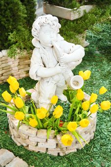 Free Boy Statue With Tulips Stock Photography - 4602052