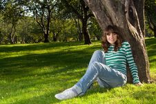 Young Woman At Park Stock Photo