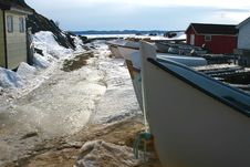 Boats On A Frozen Wharf Stock Images