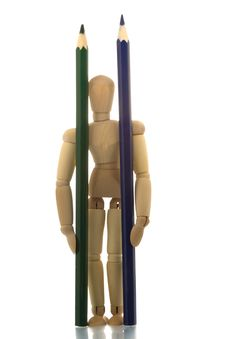Free Manikin Standing With Two Pencils Stock Image - 4607991