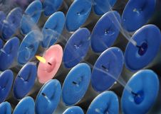 Free Pink Candle Surrounded By Blue Candles Royalty Free Stock Photography - 4608137