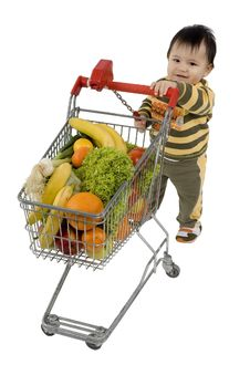 Baby With Shopping Cart Royalty Free Stock Photo
