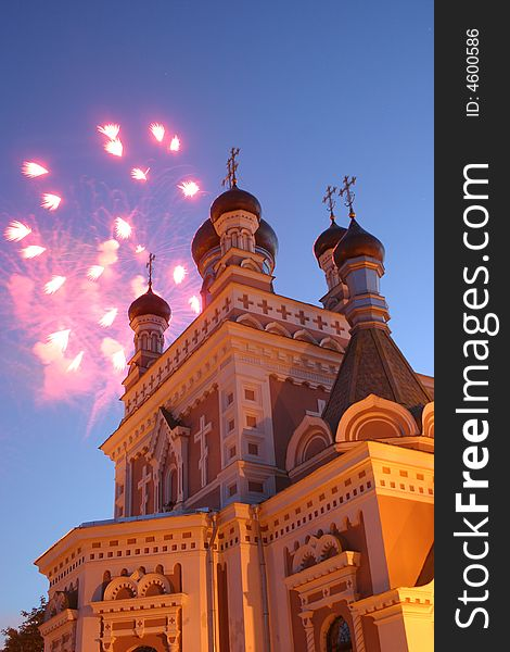 Celebratory fireworks behind chirch