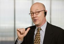 Free Businessman With A Hands-free Phone Stock Photos - 4611743