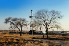 Drilling Rig And Trees Stock Photography