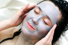 Putting A Mud Mask Royalty Free Stock Photos