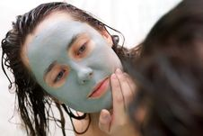 Woman Putting A Mud Mask Stock Photos