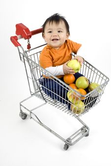 Baby In A Shopping Cart Royalty Free Stock Photography