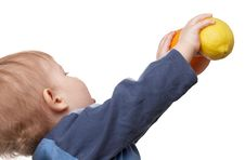 Free The Child Holds Fruit Stock Images - 4620824
