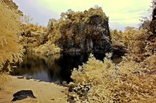 Infrared Photo – Lake, Rock, Reflection And Tree Royalty Free Stock Photos