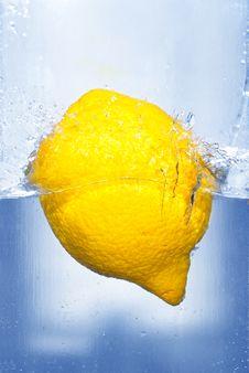 Splashing Lemon Stock Photography