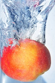 Splashing Apple Stock Photo