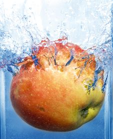 Splashing Apple Stock Image