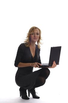 Young Beautiful Businesswoman With Laptop