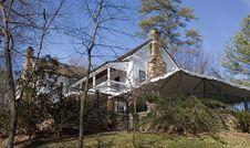Farmhouse Through The Trees Royalty Free Stock Image