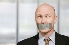 Free Cross-eyed Businessman Muzzled With Duct Tape Stock Image - 4632611