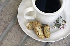 Free Cup Of Coffee With Biscotti And Flowers Royalty Free Stock Photos - 4633338