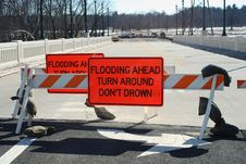 Free Flooded Roadway Sign On A Bridge Royalty Free Stock Images - 4637019